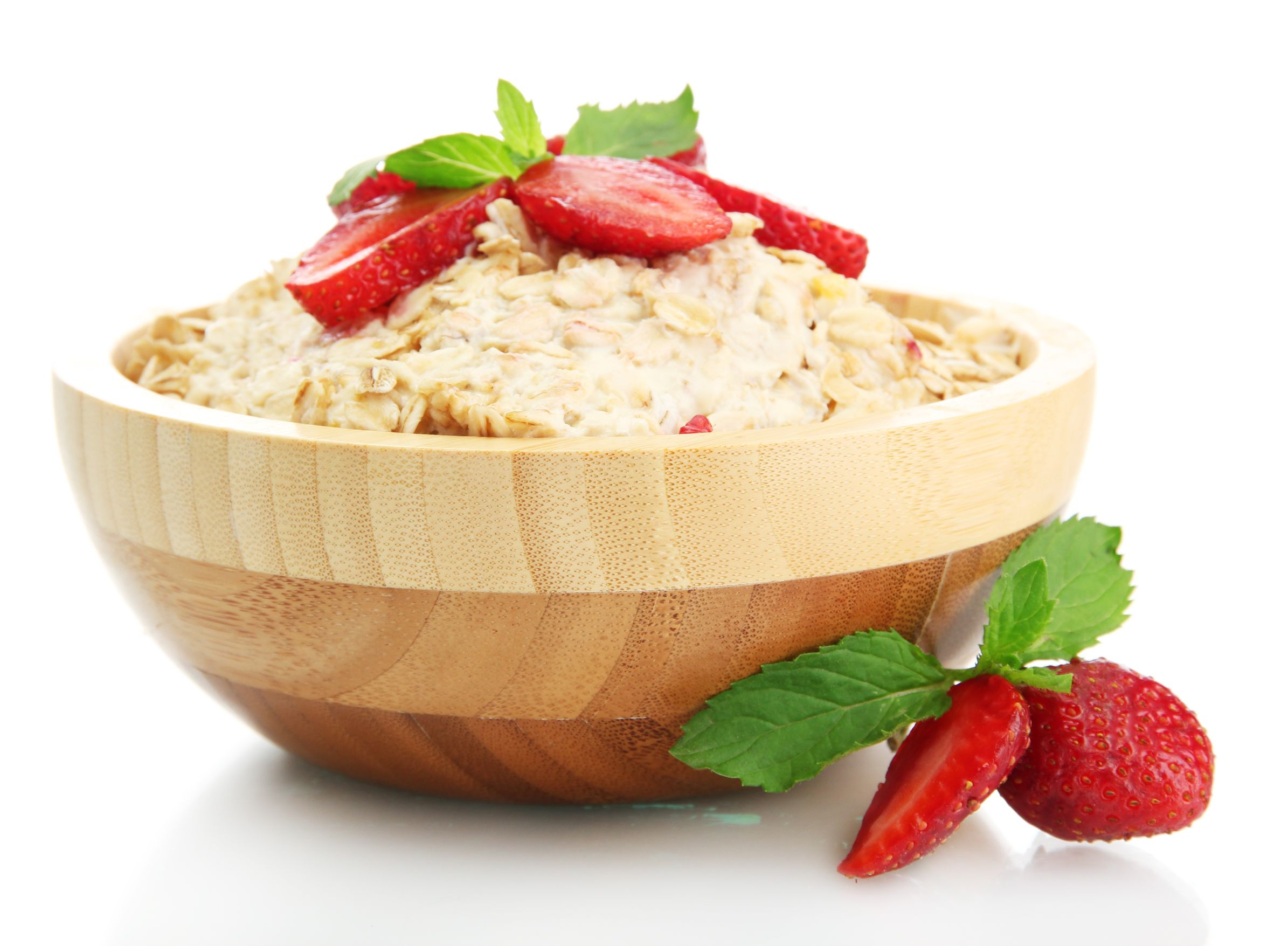 15368704 tasty oatmeal with strawberries, isolated on white