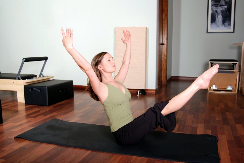 beautiful pilates instructor floor excercise