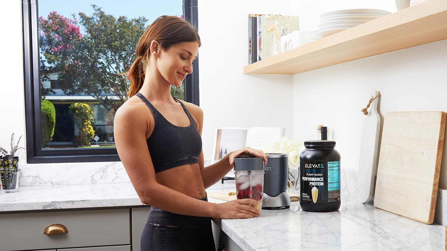 Woman Making Elevate Nutrition Protein Shake With Nutribullet